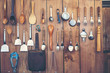 Leinwanddruck Bild - Cutlery  ladle and kitchen accessories Hanging on a wooden wall