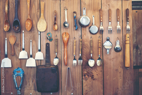 Pinturas sobre lienzo  Cutlery  ladle and kitchen accessories Hanging on a wooden wall