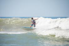 Surfer Riding A Wave