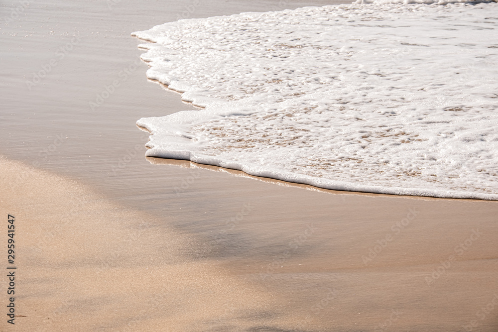 Fototapety, obrazy: Soft waves with foam of ocean on the sandy beach background