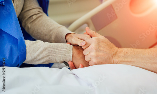 Holding patient hands in a hospital Wallpaper Mural