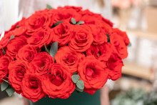 Large Bouquet In Round Box Of Red Roses. Bouquet In Woman Hand. The Work Of The Florist At A Flower Shop Flower Shop Concept