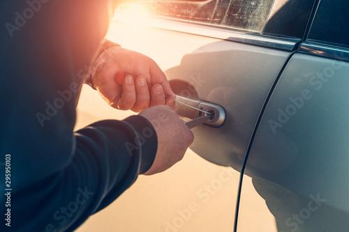 Fényképezés Car robber or thief trying to break auto door lock, close up