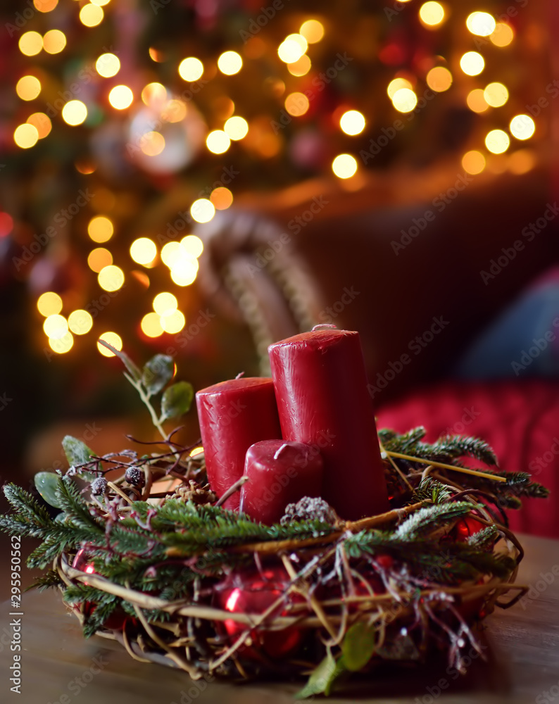 Fototapety, obrazy: Part of christmas decorating house interior. Wreath with candles, fir and red berries. Illuminating garland.