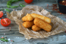 Cheese Croquettes On A Wooden Background