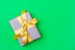 Leinwandbild Motiv Christmas Gift Box Placed On Green Background