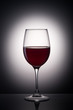 glass of wine on a gradient background