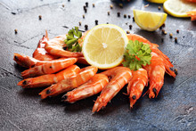Raw Fresh Prawns Langostino Austral. Shrimp Seafood With Lemon And Spices On Dark
