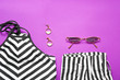 Leinwanddruck Bild - Modern female look with stylish accessories on color background