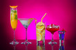 canvas print picture - Different tasty cocktails on dark color background