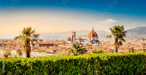 Obraz na plátně  Florence, Italy: scenic view on famous italian town with Duomo and palm trees at
