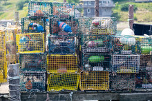 Lobster Traps Piled Up On A Do...