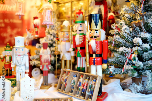 fototapeta na ścianę Christmas nutcracker sold at Christmas market in Vilnius, Lithuania. Decorated and illuminated shopping stands with variety of Xmas toys.