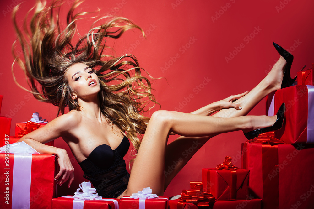 Fototapeta Luxurious long hair. Fashion hairstyle. Hair model. Girl in sexy lingerie. Happy Day. Celebration and party. Sexy blonde woman with gift.