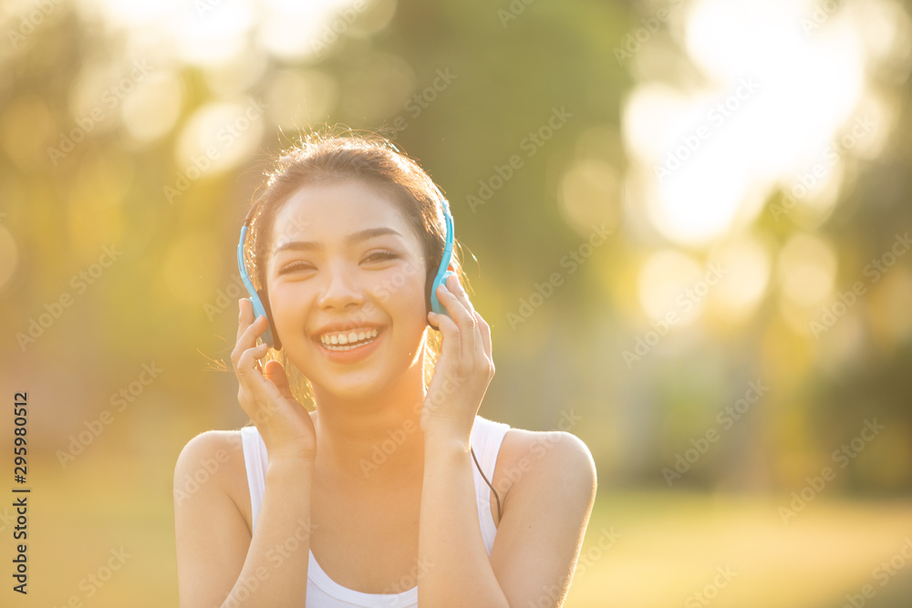 Fototapety, obrazy: Beautiful Young Woman with Headphones Outdoors. Enjoying Music