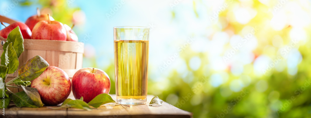 Fototapeta Apple and juice on table