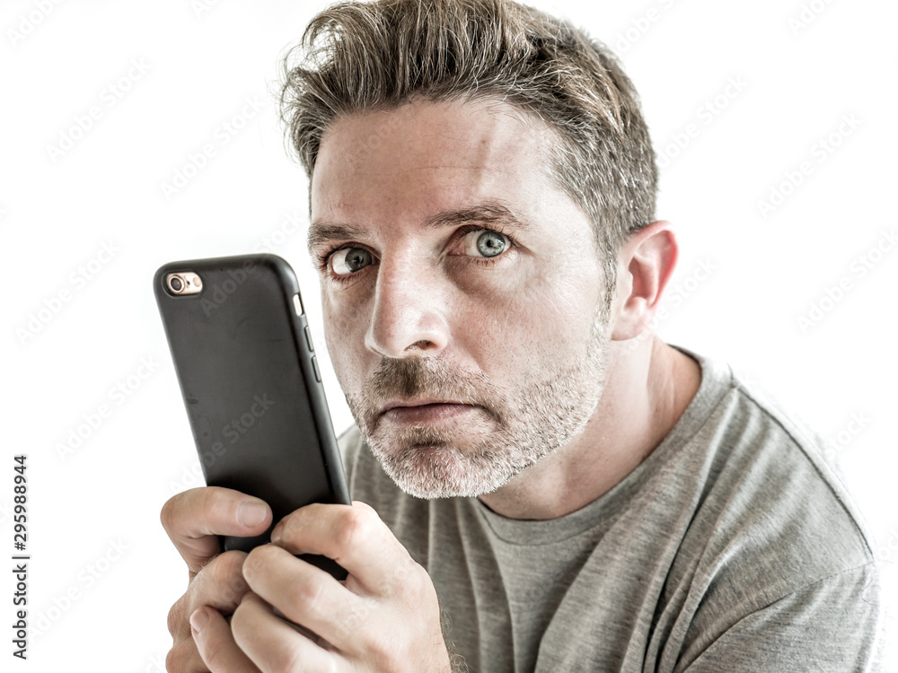 Fototapety, obrazy: freak and weird looking man using mobile phone watching something online in sick intense face expression in internet and social media addiction concept isolated