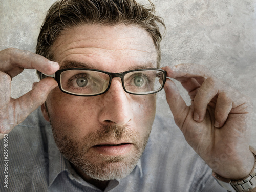 Fototapeta portrait of man wearing glasses in shock and surprise face expression