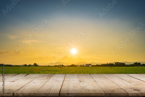 Fotografie, Obraz  Rice field sunset and Empty wood table for product display and montage