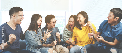 Valokuvatapetti Banner of asian group of friends talking and laughing with happy in gathering meeting sitting at home feeling cheerful and enjoy game in leisure time together