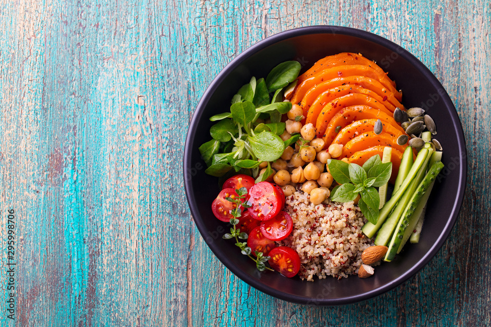 Fototapety, obrazy: Healthy vegetarian salad. Buddha bowl. Blue wooden background. Top view. Copy space.