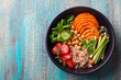 Healthy vegetarian salad. Buddha bowl. Blue wooden background. Top view. Copy space.