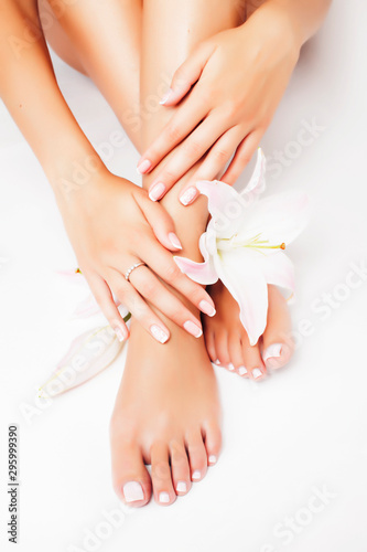 Cadres-photo bureau Manicure manicure pedicure with flower lily close up isolated on white perfect shape hands spa salon