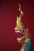Golden Dragon Figure On A Red Background