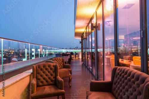 фотография  Interior of a rooftop hotel bar restaurant terrace