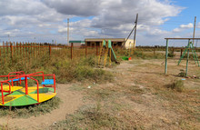 Abandoned Playground In The Village. Bright Carousel. Astrakhan Region. Russia.