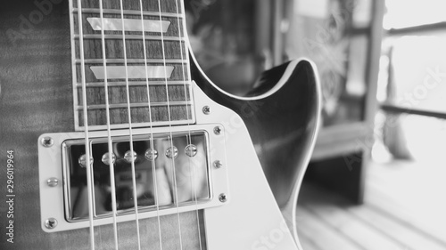 electric guitar on the wooden boards closeup - 296019964