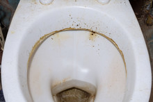 Unwashed Public Toilet. Dirty Toilet Bowl Close-up.