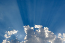 Cloud With Sun Rays In Blue Sky