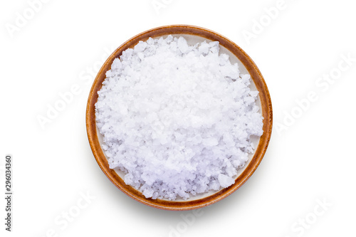 Fototapeta Closeup coarse or rock natural sea salt in brown bowl isolated on white background. Clipping path. Top view. obraz