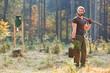 canvas print picture - Junger Förster im Wald beim Baum pflanzen
