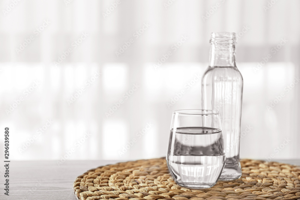 Fototapety, obrazy: Glass and bottle of fresh water on table indoors