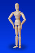 Leinwandbild Motiv Dancing wooden toy figure on blue