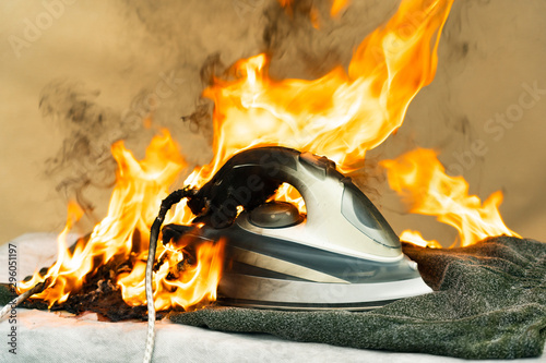 They forgot to turn off the electric iron for ironing clothes Fototapet