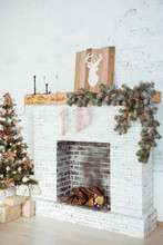 Christmas Fireplace Decorated With Fir Branches, Candles And A Garland. Close-up. Selecive Focus
