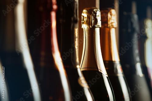 Obraz Underground cellar with elite sparkling wine on shelves, close up horizontal photo. - fototapety do salonu