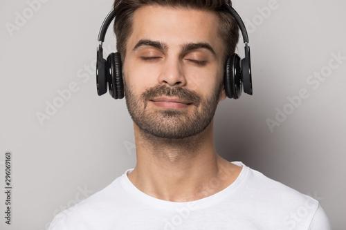 Close up of caucasian man enjoy sound in Bluetooth earphones Tableau sur Toile