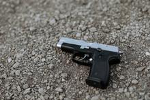 Handgun On The Ground, Close-up.
