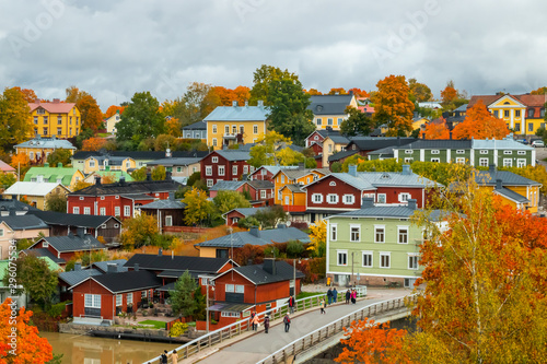 Photo Stands Old building View of old Porvoo, Finland. Beautiful city autumn landscape with colorful wooden buildings.