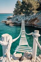 Rope Bridge Over A Cliff In Pu...