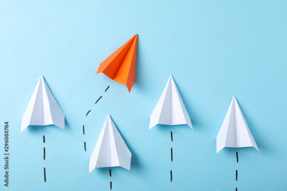 Fototapeta Paper airplanes on blue background, space for text