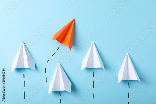 Obraz Paper airplanes on blue background, space for text - fototapety do salonu