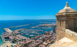 Alicante, Comunitat Valenciana / Spain - July 29th, 2019: View of the port as seen from the Santa Barbara Castle with a checkpoint in the foreground