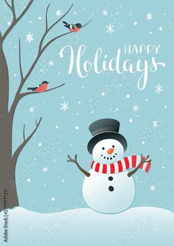 Fototapeta Winter holidays or Christmas background with snowman and snowflakes