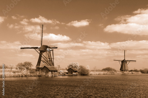 rural lanscape with windmills at famous tourist site Kinderdijk in Netherlands Wallpaper Mural