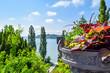 Leinwanddruck Bild - Flower bunch in front of beautiful landscape Lake Constance, isle of Mainau